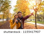 happy young couple exploring in ... | Shutterstock . vector #1155417907
