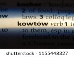 Small photo of kowtow word in a dictionary. kowtow concept.