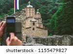 man taking a photo of a serbian ... | Shutterstock . vector #1155479827