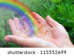 Rainbow In Female Hands