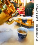chiness tea was poured from... | Shutterstock . vector #1155529507