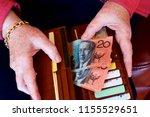 a woman taking australian money ... | Shutterstock . vector #1155529651