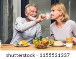 senior couple enjoy eating ... | Shutterstock . vector #1155531337