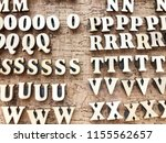 white letters on a brown wooden ... | Shutterstock . vector #1155562657