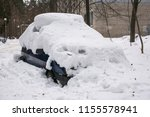 the car  covered with thick... | Shutterstock . vector #1155578941