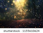 Small photo of blurred abstract photo of light burst among trees and glitter golden bokeh lights