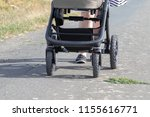 front view on a buggy shoving...   Shutterstock . vector #1155616771