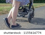 mother shoving a buggy with her ...   Shutterstock . vector #1155616774