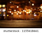 image of wooden table in front... | Shutterstock . vector #1155618661