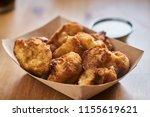crispy fried cauliflower bites... | Shutterstock . vector #1155619621