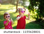 two cute little girlfriends... | Shutterstock . vector #1155628831