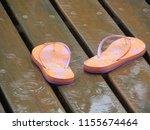 Flip Flops In The Rain. Orange...