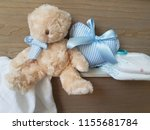 baby diapers and teddy bear set ... | Shutterstock . vector #1155681784