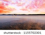 colorful sunset above the sea.... | Shutterstock . vector #1155702301