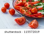 Salad made from tomato and mozzarella on plate - stock photo