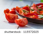 Closeup of salad made from tomato and mozzarella - stock photo