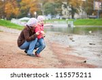 mother and daughter together on ... | Shutterstock . vector #115575211