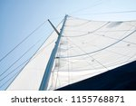 mast and white sail from above | Shutterstock . vector #1155768871