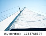 mast and white sail from above | Shutterstock . vector #1155768874