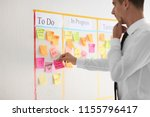 man with sticker near scrum... | Shutterstock . vector #1155796417