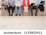 group of young people waiting... | Shutterstock . vector #1155853411