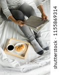 woman reading book or newspaper ... | Shutterstock . vector #1155869314