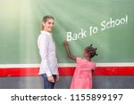 female teacher happy in primary ... | Shutterstock . vector #1155899197
