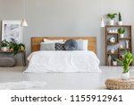 plant on pouf in bright bedroom ... | Shutterstock . vector #1155912961