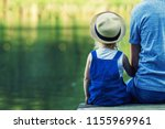 dad and a tiny girl in... | Shutterstock . vector #1155969961