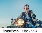 biker man with motorcycle on... | Shutterstock . vector #1155970657