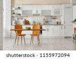 stylish kitchen interior with... | Shutterstock . vector #1155972094