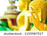 golden buddha from thailand... | Shutterstock . vector #1155987517