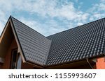 modern roof covered with tile... | Shutterstock . vector #1155993607
