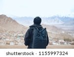 young wanderlust traveler with... | Shutterstock . vector #1155997324