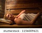 young woman relaxing in a sauna ... | Shutterstock . vector #1156009621