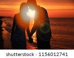silhouette of a loving couple... | Shutterstock . vector #1156012741