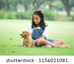 little girl playing with a cute ... | Shutterstock . vector #1156021081