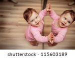 happy one year old baby girl... | Shutterstock . vector #115603189