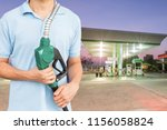 man hold fuel nozzle to add...   Shutterstock . vector #1156058824