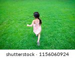 girl playing on the lawn | Shutterstock . vector #1156060924