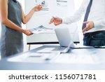 asian business adviser meeting... | Shutterstock . vector #1156071781