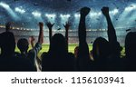 fans celebrating the success of ... | Shutterstock . vector #1156103941
