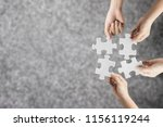 hand holding jigsaw puzzle with ... | Shutterstock . vector #1156119244