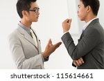 partners having a discussion... | Shutterstock . vector #115614661