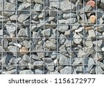 gabione as noise barrier | Shutterstock . vector #1156172977