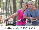 couple biking | Shutterstock . vector #115617559