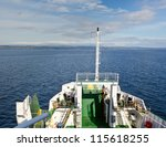 Passenger car ferry  crossing the bay in Scotland - stock photo