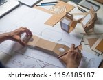 designer sketching drawing... | Shutterstock . vector #1156185187