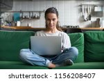 serious woman using laptop... | Shutterstock . vector #1156208407