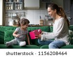 smiling mom giving excited... | Shutterstock . vector #1156208464